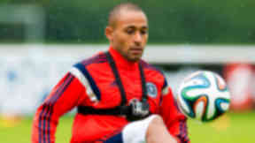 Ikechi Anya trains with the rest of the Scotland squad in Middlesex.