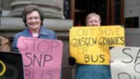 Pensioners protest against bus cuts outside the city chambers
