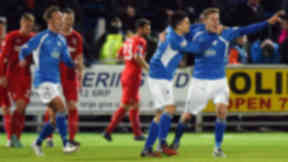 Queen of the South's Kevin Holt (right) celebrates after putting his side 1-0 up.