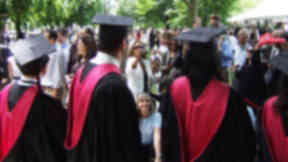 University graduates from Harvard University. Note: NOT Scottish university graduates uploaded March 24 2015 Quality news image. Used to illustrate Migrants with qualifications story