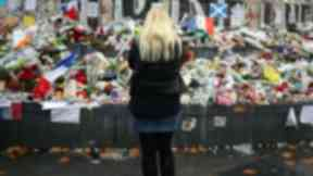 Woman looks at tributes to Paris terrorist attacks. Uploaded from PA November 18 2015