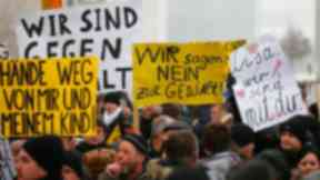 Russian-German protesters demonstrated outside the Chancellery in Berlin on January 23, one holding a placard reading: 'Lisa, we are with you'.