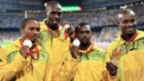 Usain Bolt (2nd L) was part of the 4x100m Jamaican relay team with Nesta Carter (2nd R)