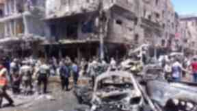 Syrian Army members inspect a damaged site after a suicide and car bomb attack in south Damascus.