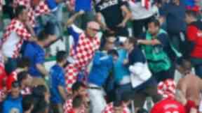 Fans clash during the Czech Republic v Croatia football match on June 17.