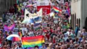 Pride parade: People march down the Royal Mile in Edinburgh on Saturday.