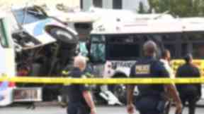 Police at the scene of the bus smash in Newark.