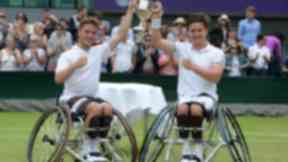 Gordon Reid (right) celebrates his victory in the men's wheelchair doubles at Wimbledon with Alfie Hewett (left).