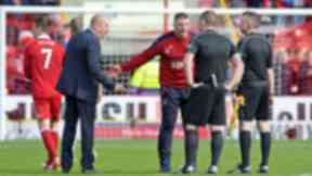 Mark Warburton on the pitch at Pittiodrie.