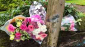 Tributes: Flowers left at scene of fatal crash.