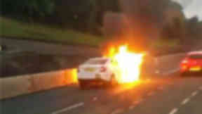 Car bursts into flames on busy motorway causing delays