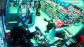 CCTV: Robber carrying axe caught on shop's CCTV.