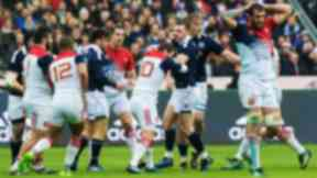 Scotland's Stuart Hogg clashes with France's Camille Lopez