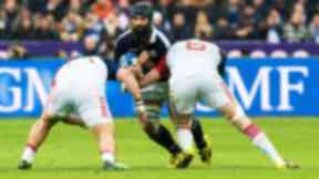 Scotland's Josh Strauss in action (C) against France's Loann Goujon (6)