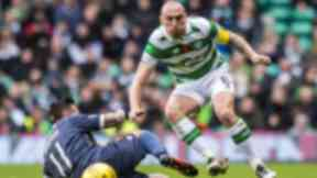 Celtic's Scott Brown (right) is tackled by Ryan Bowman