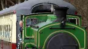 Prince of Wales aka Prince Charles driving steam train in Aberdeenshire