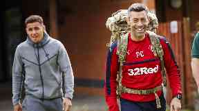Pedro Caixinha with a rucksack