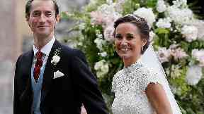 James and Pippa leave church as man and wife.