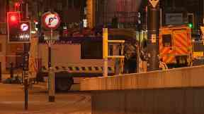 Police carry out a controlled explosion outside Manchester Arena.