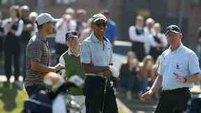 Former US president Barack Obama prepares to tee off at the first hole at St Andrews Golf Club.