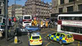 Female cyclist knocked down by Rabbie's tour bus on Princes Street in Edinburgh