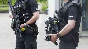 Armed police on patrol outside Scottish Parliament Holyrood Edinburgh Police Scotland
