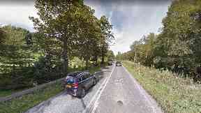 Crash: Two people were cut free after the collision on the A941.