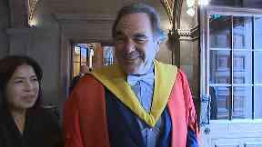 Oliver Stone collecting Edinburgh University honorary degree