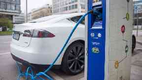 A Tesla S electric car is charged.
