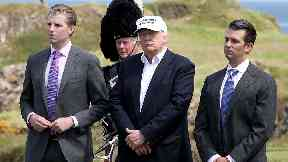 Eric Trump, Donald Trump and Donald Trump Jr at Trump Turnberry golf course in Ayrshire