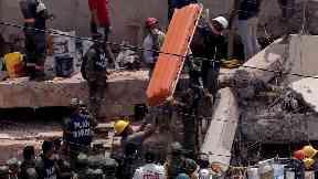 Rescuers search for survivors in a Mexico City school