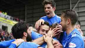 Aberdeen's Andrew Considine (centre) celebrates with his teammates after scoring the opening goal.