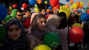 Kurdish women held balloons to protest against the international flight ban.