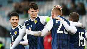 Scotland's Oliver Burke celebrates with goalscorer Oliver McBurnie.