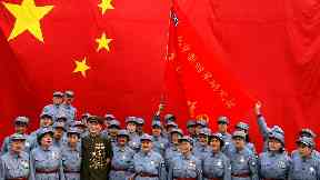 An army choir after an event dedicated to China's national anthem.
