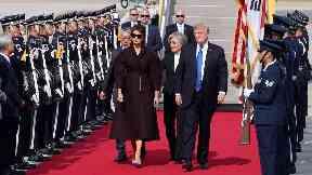 President Donald Trump and first lady Melania Trump arrive at U.S. Osan Air Base in Pyeongtaek.