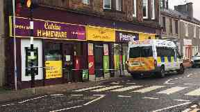 Catrine: Officers cordoned off the shop. East Ayrshire