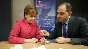Nicola Sturgeon takes HIV test with George Valiotis, CEO of HIV Scotland. November 2017