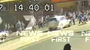 The car drove into pedestrians outside a Melbourne train station.