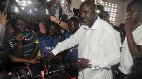 George Weah casts his vote in the presidential election.