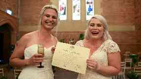 Sarah Turnbull (left) and Rebecca Hickson pose for a photograph with their Certificate of Marriage after being married in a ceremony in Newcastle, Tuesday, January 9, 2018.