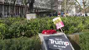 An anti-Trump Banner at Ronald Reagan statue in front of the US Embassy in London.