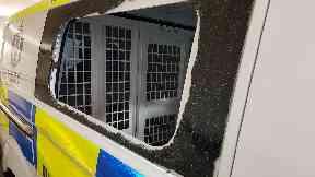 Police van's window smashed in and officers' hats stolen in Blackridge, West Lothian.