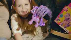 Kara McNair, four-year-old girl from Paisley with her 3d-printed prosthetic hand.