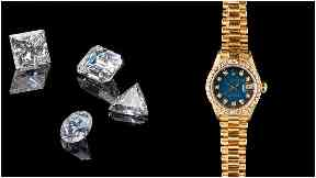 Diamonds and watches seized from fraudster Ronnie Decker.