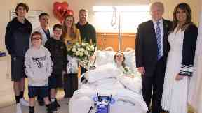 Donald and Melania Trump visit one of the victims.