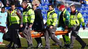 Blow: Djoum was stretchered off.