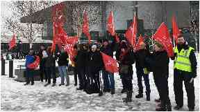 Workers on strike outside the Emirates Arena
