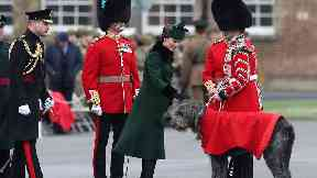 The Duchess presented shamrocks to the Irish guards including mascot dog Domhnall.