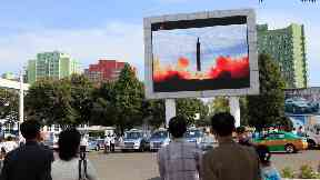 people watch missile launch in Pyongyang